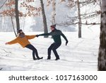 young beautiful couple playing... | Shutterstock . vector #1017163000