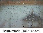 raindrops on the glass window... | Shutterstock . vector #1017164524