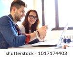teamwork concept.young creative ... | Shutterstock . vector #1017174403
