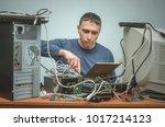 computer technician holding in... | Shutterstock . vector #1017214123