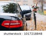 wedding bouquet in groom hand... | Shutterstock . vector #1017218848