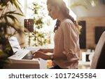 beautiful woman playing piano  | Shutterstock . vector #1017245584