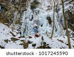 the waterfall which froze and... | Shutterstock . vector #1017245590