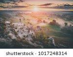 hiker standing on a roky hill... | Shutterstock . vector #1017248314