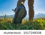 hiker walking by the mountain... | Shutterstock . vector #1017248338