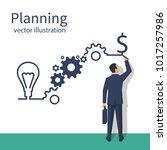 businessman draws business... | Shutterstock .eps vector #1017257986