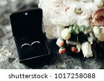 stylish golden wedding rings in ... | Shutterstock . vector #1017258088