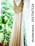 white wedding dress on hanger