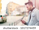 handsome man cell phone call... | Shutterstock . vector #1017274459