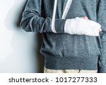 plastered arm  a broken arm at... | Shutterstock . vector #1017277333