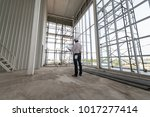 male engineers are standing... | Shutterstock . vector #1017277414