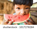 close up asian kid eating... | Shutterstock . vector #1017278284