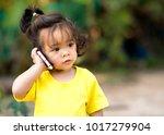 little girl listen and using... | Shutterstock . vector #1017279904