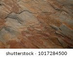 rust stone wall or grunge stone ... | Shutterstock . vector #1017284500