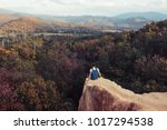 young traveller sitting on the... | Shutterstock . vector #1017294538