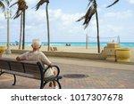 elderly retired man enjoying... | Shutterstock . vector #1017307678