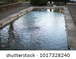 Small photo of large fountain in public park during daytime whit springs pouring and agitating the waters