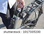 women holding battery pack of...   Shutterstock . vector #1017335230