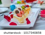 cake cut into pieces on the... | Shutterstock . vector #1017340858