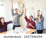 joyful business people under... | Shutterstock . vector #1017346354