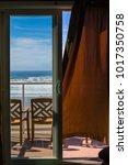 view of the open balcony doors... | Shutterstock . vector #1017350758