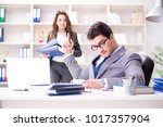 angry boss unhappy with female... | Shutterstock . vector #1017357904