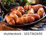 pigs in blankets. mini sausages ... | Shutterstock . vector #1017362650