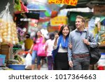 young couple tourists walking... | Shutterstock . vector #1017364663