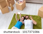 young family unpacking at new... | Shutterstock . vector #1017371086