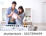 young parents expecting their... | Shutterstock . vector #1017394459