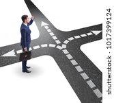 young businessman at crossroads ...   Shutterstock . vector #1017399124