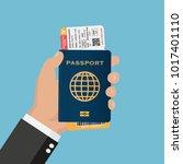 hand holding passport with... | Shutterstock .eps vector #1017401110