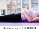 pregnant woman exercising in... | Shutterstock . vector #1017401353