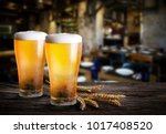 glasses of light beer with... | Shutterstock . vector #1017408520