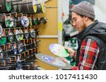 a young man chooses discs for... | Shutterstock . vector #1017411430