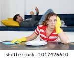 frustrated woman cleaning room... | Shutterstock . vector #1017426610