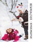 winter. cute children having... | Shutterstock . vector #1017456928