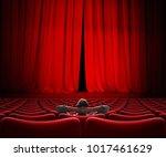 man sitting alone in vip movie... | Shutterstock . vector #1017461629