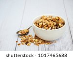 bowl with granola  on a old... | Shutterstock . vector #1017465688