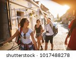 four attractive students... | Shutterstock . vector #1017488278