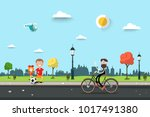 man on bicycle with children on ... | Shutterstock .eps vector #1017491380