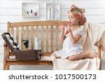 little girl play in the beauty... | Shutterstock . vector #1017500173