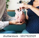family saving money in piggy... | Shutterstock . vector #1017522529