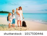 mother with kids travel on... | Shutterstock . vector #1017530446