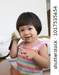 Small photo of a girl talk on telephone in bedroon
