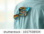 paper fish on man's back ... | Shutterstock . vector #1017538534