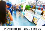 blurred people shopping at... | Shutterstock . vector #1017545698