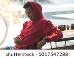 sport man in red hood listening ... | Shutterstock . vector #1017547288