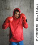 boxer in red hood with wall... | Shutterstock . vector #1017551638