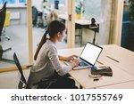 businesswoman sitting at... | Shutterstock . vector #1017555769